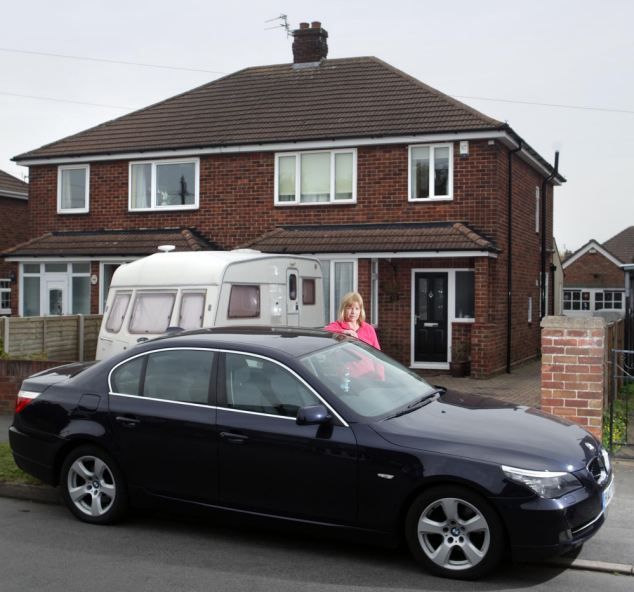 The mother-of-two says she planned to move the car on to her driveway after sheltering indoors from a hailstorm