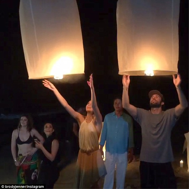 Letting go: The duo set their lamps free