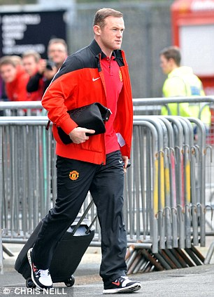 Warming up: Wayne Rooney arrives for a light training session at Old Trafford on Tuesday
