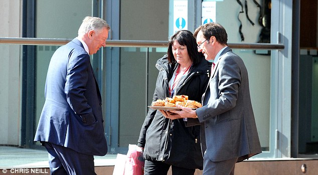 Yum: Fergie was presented with a tray of delicious-looking pastries by club staff on his arrival