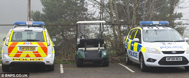 Police were left baffled today after discovering a badly decomposed body in woodlands at a golf course