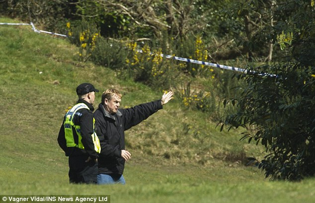 Grizzly: A man points police in the direction of where he found the human bones in Bournemouth