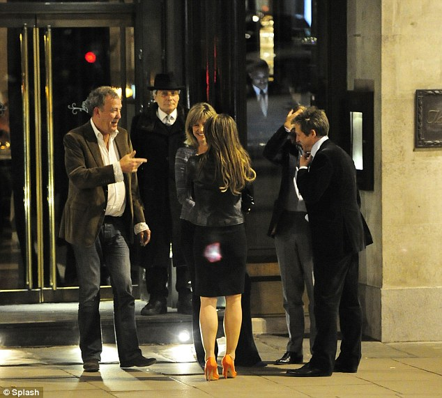 What a gathering: Jeremy Clarkson and his blonde companion were spotted chatting to Elizabeth Hurley and Hugh Grant outside London's Wolseley restaurant on Monday night