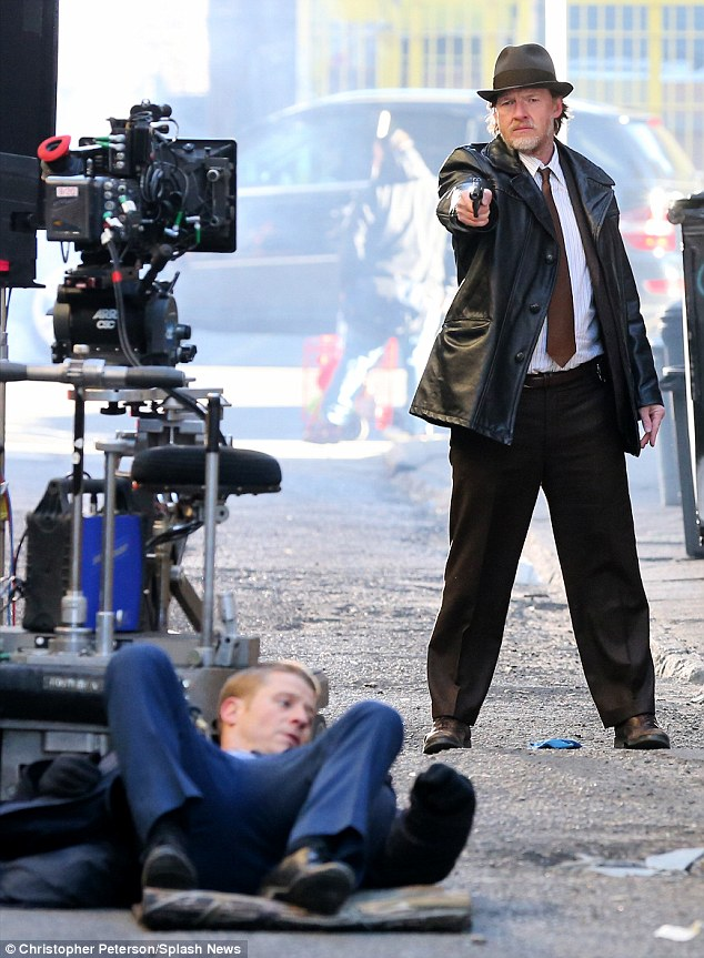 Shoot out! Gotham stars Ben McKenzie (near left) and Donal Logue were spotted filming scenes for the Fox series' pilot episode in New York City on March 26, in their roles as Detective James Gordon and Detective Harvey Bullock, respectively