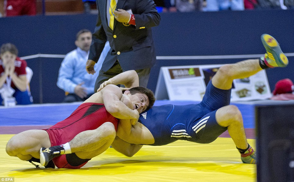 Mykola Bolotnjuk (blue) of Slovakia  against Borislav Novachov of Bulgaria in men's 65 kg bronze medal bout at the European Wrestling Championships