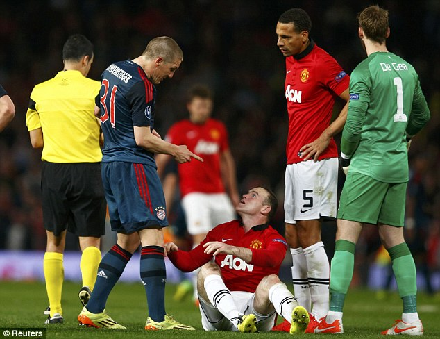 Not impressed: Schweinsteiger gestures to Rooney that he dived