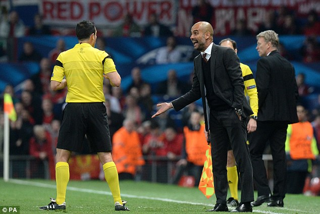Making his point: Pep Guardiola argues with the referee after Schweinsteiger's sending off
