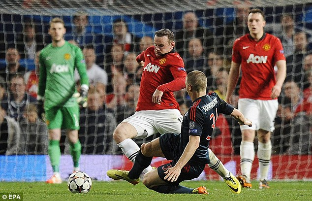 Going down: Bastian Schweinsteiger fouls Wayne Rooney and is subsequently sent off