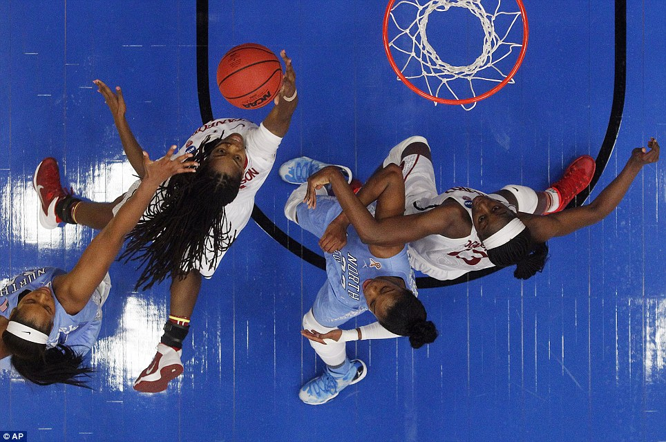 Stanford guard Lili Thompson goes up for a shot next to North Carolina forward Xylina McDanield (left) and guard Diamond DeShields