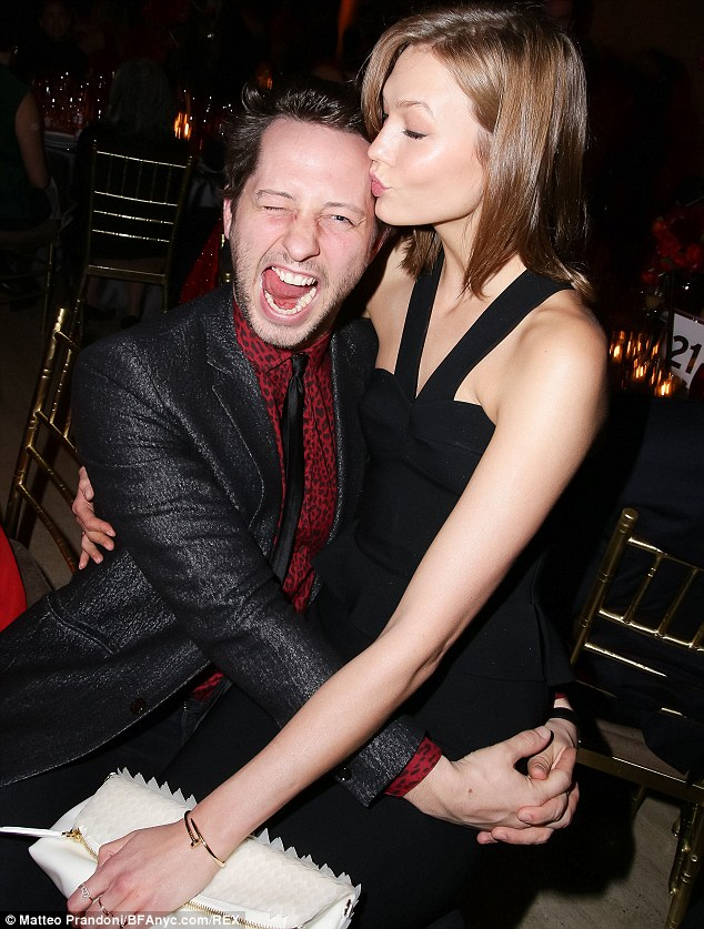 Lucky: Derek Blasberg gets a playful kiss from the beautiful Karlie Kloss in NYC