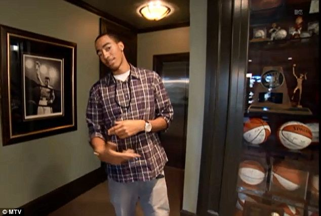 Sporty: The home also has a trophy room where Bradley keeps his many sports trophies and signed balls and other memorabilia