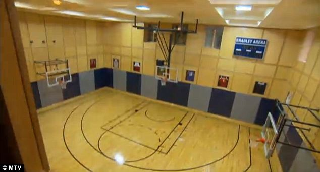 Easy breezy: The indoor basketball court dubbed Bradley Arena is just one of the home's outrageous features