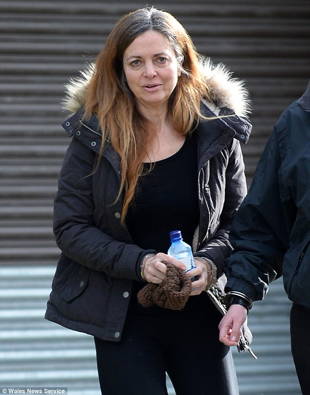 'Beneifts cheat': Tracy Johnson, 52, claimed £50,000 while travelling the world. She is pictured at Merthyr Tydfil Crown Court