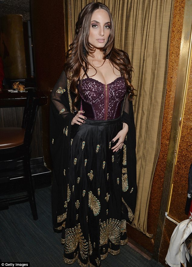 Sultry: Alexa looked amazing in a lace corset top, black flowing skirt with gold detail and matching jacket