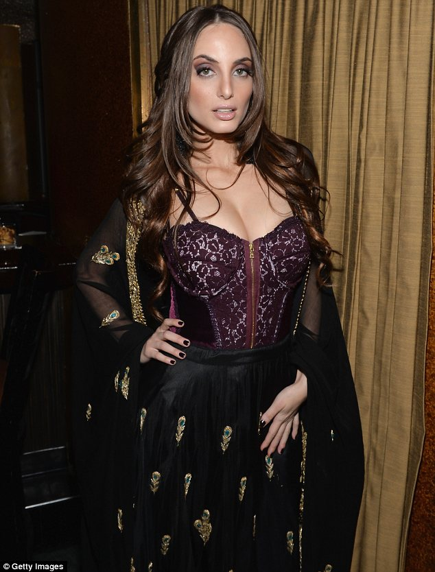 Showcasing her ample cleavage: The deep plum top did little to quash rumours Alexa has had breast augmentation surgery