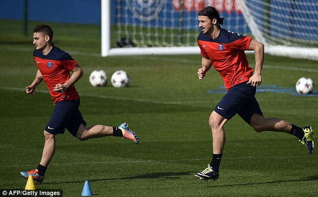 Training days: Ibrahimovic (right) will be involved in a fascinating battle with Terry in Paris on Wednesday