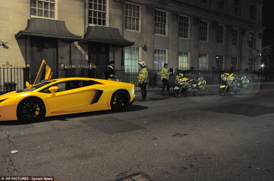 Stopped: The driver of this £300,000 Lamborghini Aventador was stopped on Park Lane last night days after a crash involving a different supercar driver in London