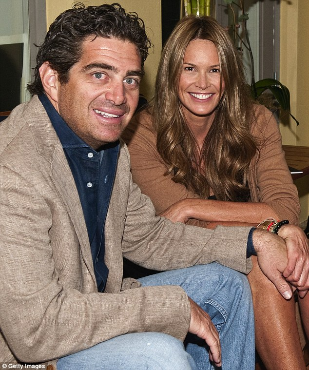 Paltrow spent time with him: Jeffrey Soffer, pictured with wife Elle Macpherson in December, has yet to deny he had a romantic link with the blonde beauty