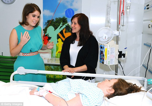 Princess Eugenie chats to patient Chloe Golding and her mother Marie Golding during her visit to the hospital, where she herself was admitted as a child