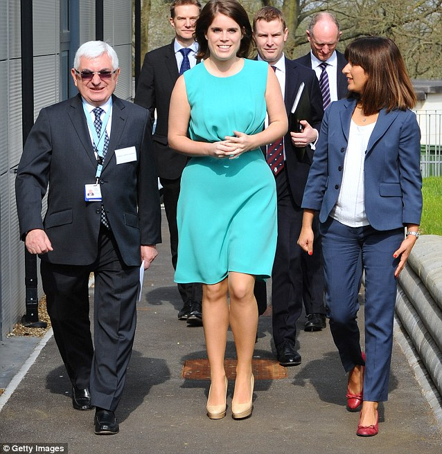 Princess Eugenie chose a bright outfit to match the sunshine for the visit, emphasising her slim figure with a cinched in waist