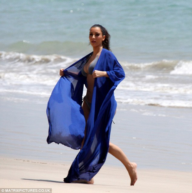 Enjoying herself: Kim has been blissfully immersing herself in the sea each day on her gorgeous vacation