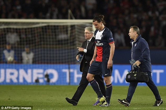 Night over: Ibrahimovic leaves the pitch after picking up a hamstring injury