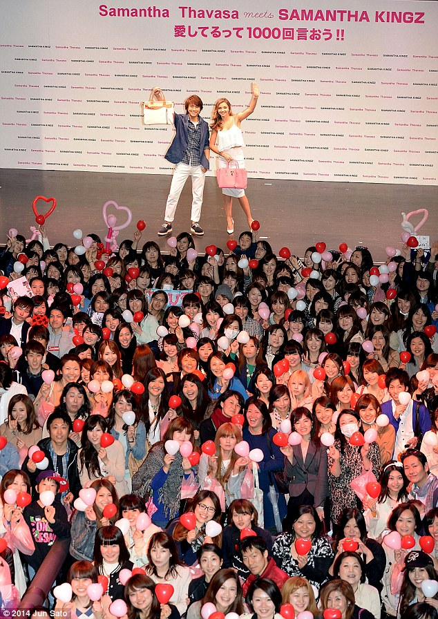 Public speaking: The beautiful brunette and Takahiro represented the brand on stage, speaking to a sea of onlookers - most of whom held little pink and red balloons