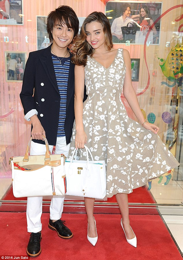 Famous friends: Miranda Kerr posed for photos with Takahiro, a member of the Japanese boy band, EXILE, while attending a Samantha Thavasa fan event in Tokyo on Thursday