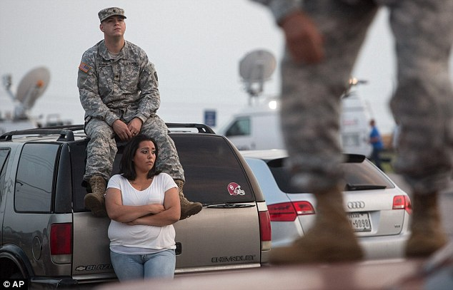 Anxious wait: Lucy Hamlin and her husband Timothy, wait to be allowed back on the base where they live