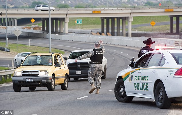 Lock down: Military police stop traffic on the way into the Texas base