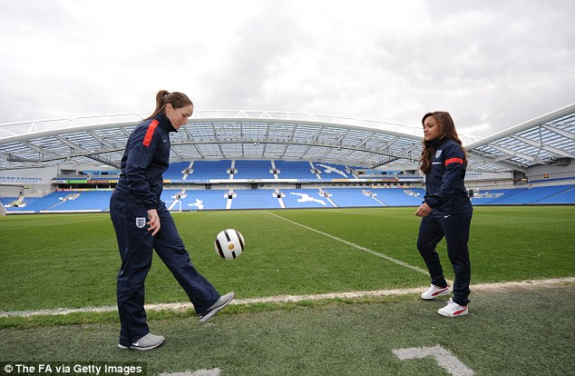 Kick around: England players Alex Scott and Casey Stoney at the Amex Stadium in Brighton, where they will play Montenegro on Saturday