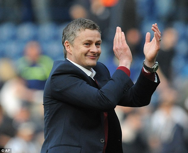 Chuffed: Cardiff manager Ole Gunnar Solskjaer applauds the travelling supporters after gaining an improbable point at The Hawthorns