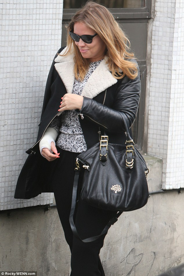 The Loving Kind: The star finished off her off-duty look with black shades, matching trousers and a Mulberry handbag