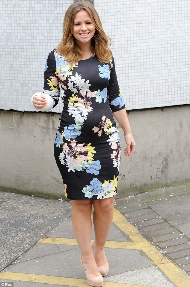 Bump watch: Kimberley Walsh showed off her pregnant tum in a black floral dress as she left the Loose Women studios on Thursday