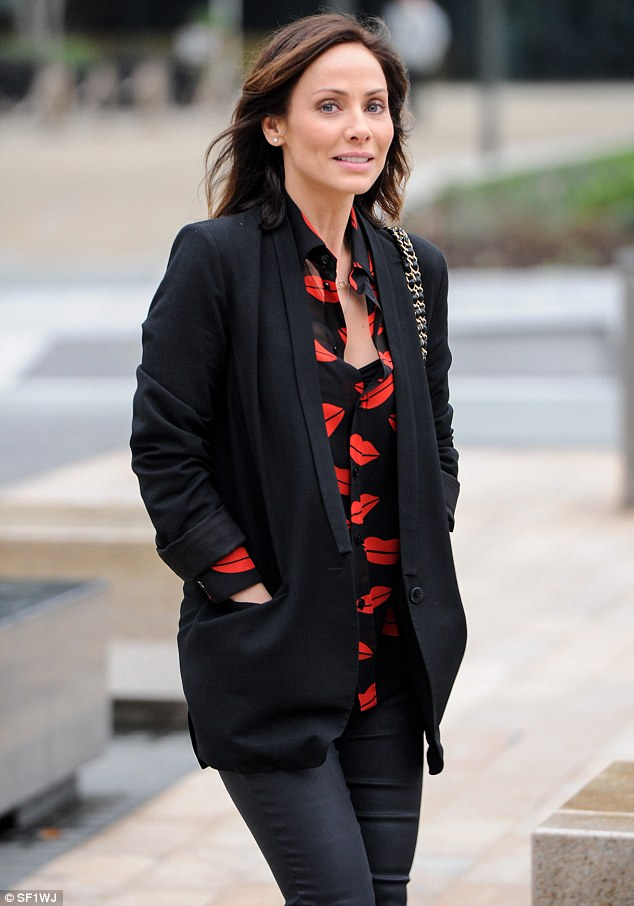 Flawless: The 39-year-old Australian singer and former Neighbours star teamed the statement number with a black blazer and highlighted her youthful complexion with minimal makeup