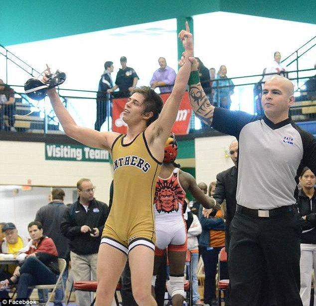Triumph: Heard won a state championship title last year while competing in 113-pound weight class for his Texas school