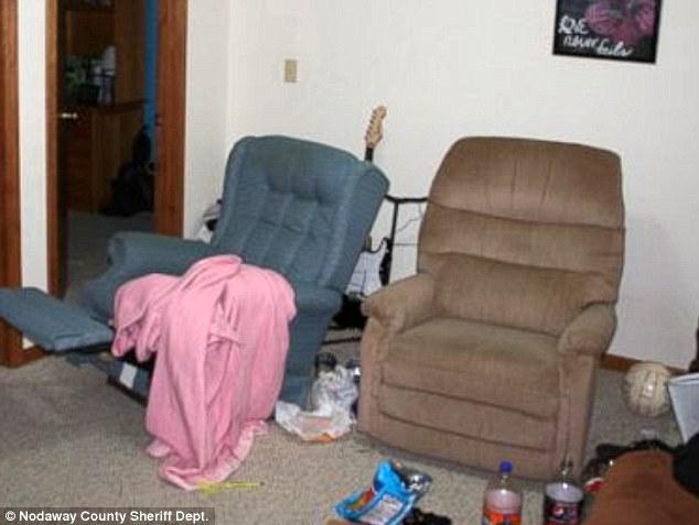 Scene: Photo of Matthew Barnett's family basement where the teens were drinking on the night of January 8, 2012.