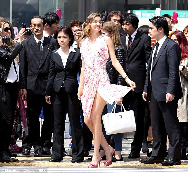 Quite a crowd: Miranda is the centre of attention during her latest outing in Tokyo