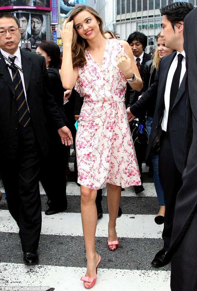 Stepping out: Miranda Kerr draws a crowd as she makes an appearance in Tokyo's Shibuya shopping district on Thursday