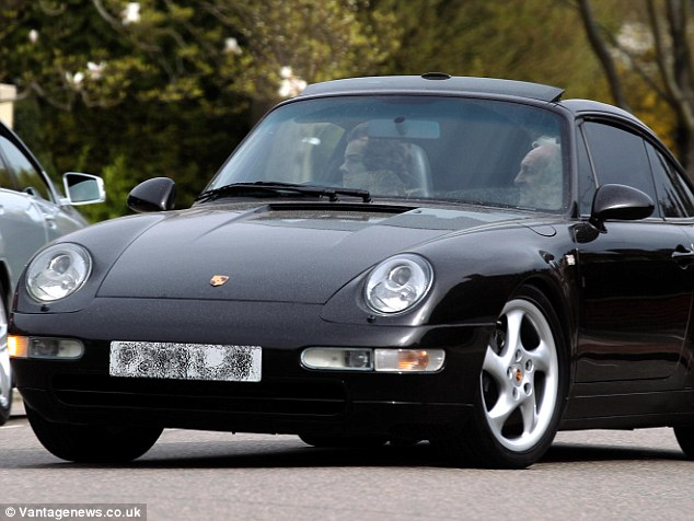 Taking a spin: Harry and Harold take the Porsche out for a drive