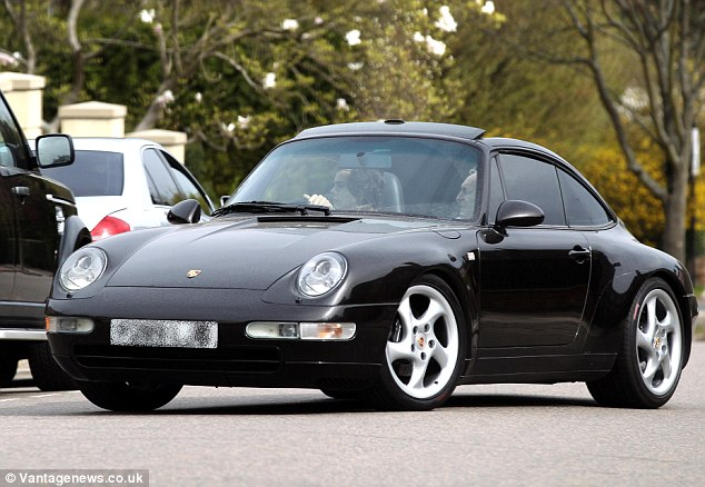 New addition to the family: Harry appears to be infatuated with the Porsche