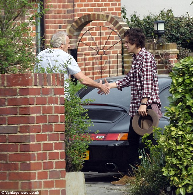Shaking on a deal: Harry and Harold appear to have shaken hands over the car