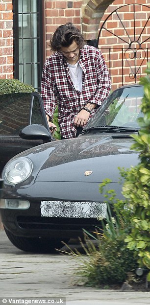 Sports car crazy: Harry to known for his love of fast cars
