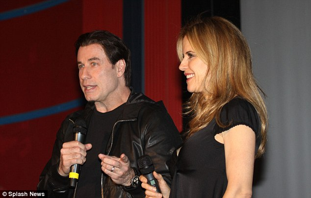 Moral support: The star was joined by wife Kelly Preston as they made a brief speech before kicking off the festivities with a champagne toast