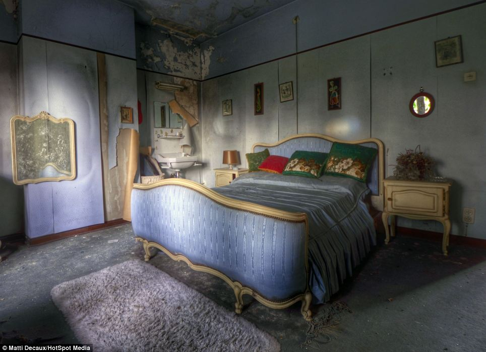 Not quite the NHS: Patients would recline in a king size bed with plush blue satin sheets and a gold wooden frame facing the open windows