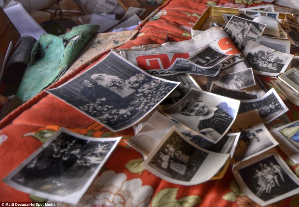 Memories: Boxes of photographs all over the house span generations, including the family's landmarks events like weddings, births and birthdays