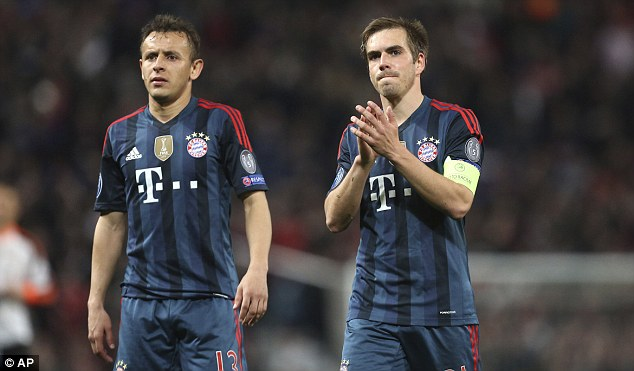 Versatile: Lahm (right) has been converted into a deep-lying midfielder by Bayern boss Pep Guardiola