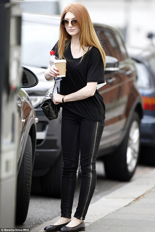 Hair she goes: Nicola Roberts stepped out in London on Friday with poker straight locks and an all-black outfit