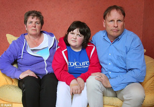 Caroline Zaple-Davies (left) and husband Simon (right) were outraged when their 13-year-old daughter Katie, who suffers from a brain tumor, was told to take the train home after a surgery