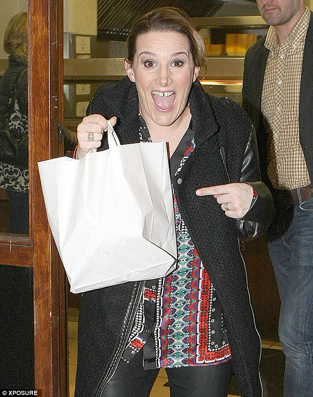 Hungry work: The singer has her hands full after a visit to a local chippy